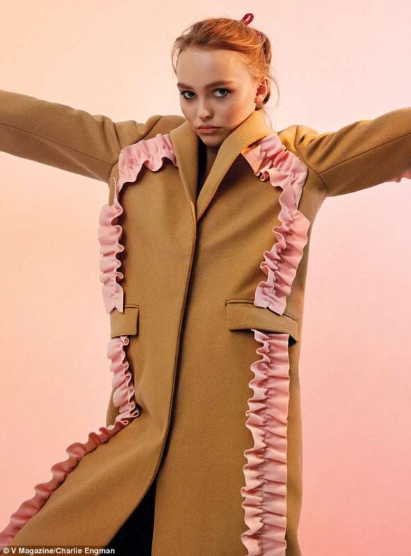 34066AB700000578-0-High_fashion_Lily_Rose_wears_a_tan_coat_with_pink_frill_trim-m-47_1462933085272