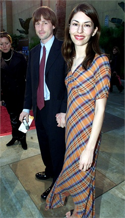 """HOLLYWOOD, : US film director Sofia Coppola (R) arrives at the premiere of her first feature film """"The Virgin Suicides"""" with her husband film director Spike Jonze (L) in Hollywood, 18 April 2000. Sophia's father, film director Francis Ford Coppola, produced the film which stars James Woods, Kirsten Dunst and Danny De Vito. (ELECTRONIC IMAGE) AFP PHOTO/Lucy NICHOLSON (Photo credit should read LUCY NICHOLSON/AFP/Getty Images)"""