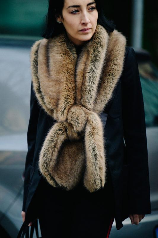 British editor wearing fur scarf