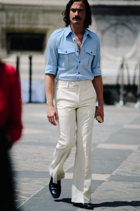 Man wearing blue shirt tucked in