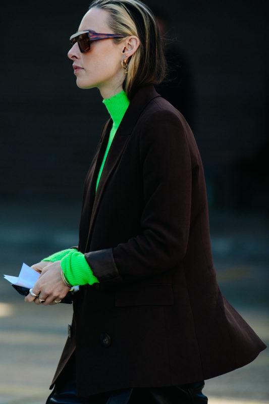 Woman wearing green jumper