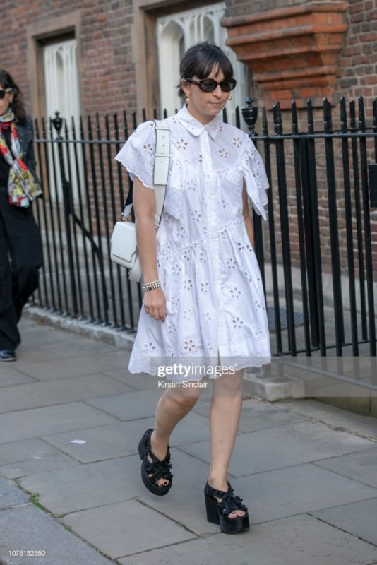 LONDON, ENGLAND - SEPTEMBER 16: Buying director of The Webster Clara Cornet wears a Simone Rocha dress and shoes and a Marge Sherwood bag during London Fashion Week September 2018 on September 16, 2018 in London, England. (Photo by Kirstin Sinclair/Getty Images)